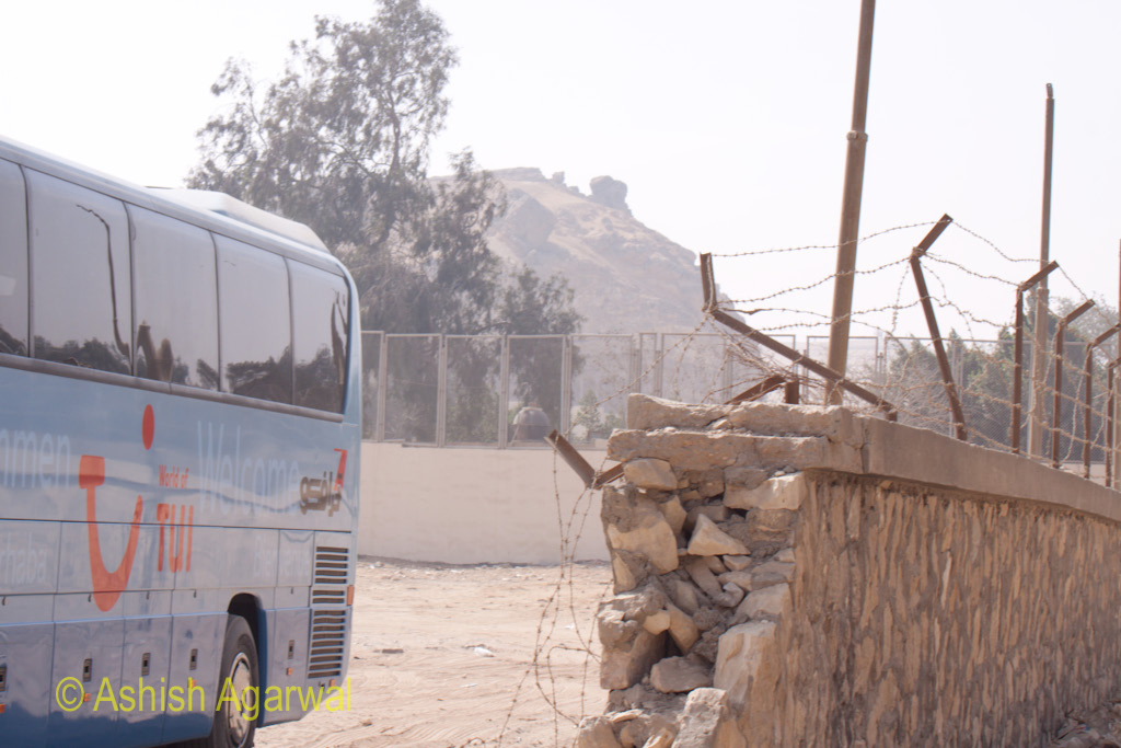 A bus parked at the parking area for tourist buses near the Great Pyramid in Giza