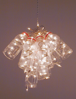 The ko box diy plastic bottle chandelier this is the perfect diy project for me since i drink fiji water and have a way too huge collection of the bottles bagged up for recycle in my truck mozeypictures Image collections