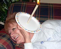 Jo Jo burning an ear candle