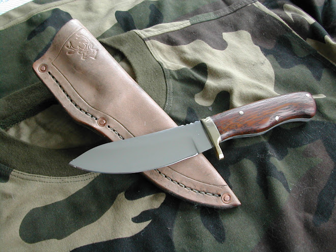 Kwilla handled drop point hunter in D-2 steel