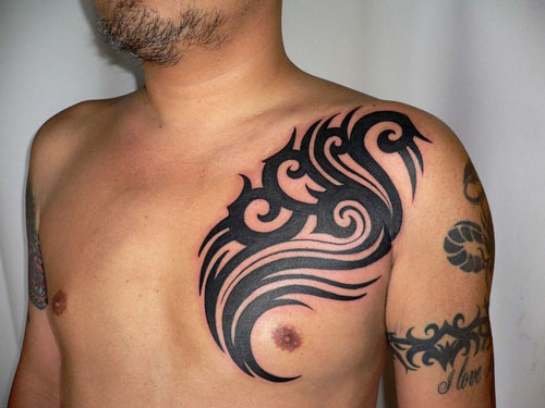 Tribal Chest Tattoos for Men. A tribal tattoo design here draws attention to
