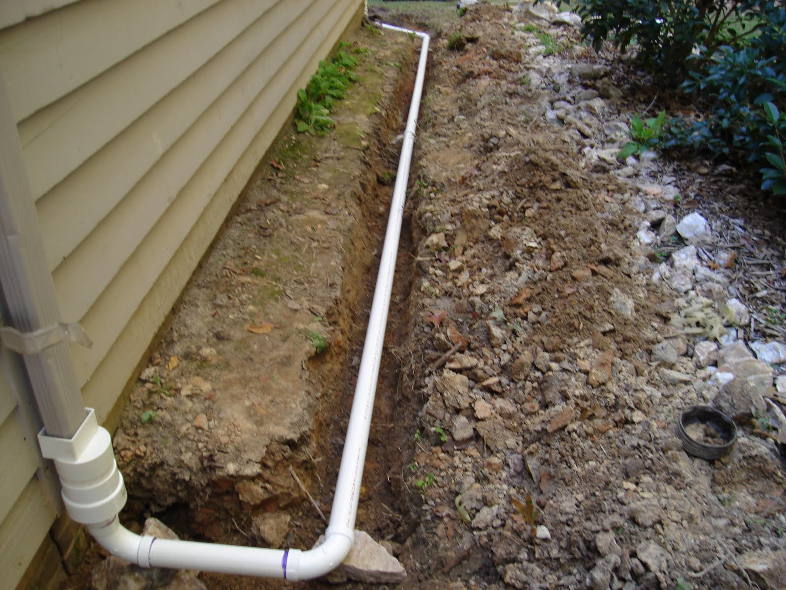 From mind to machine installing a downspout drain for Downspout drain