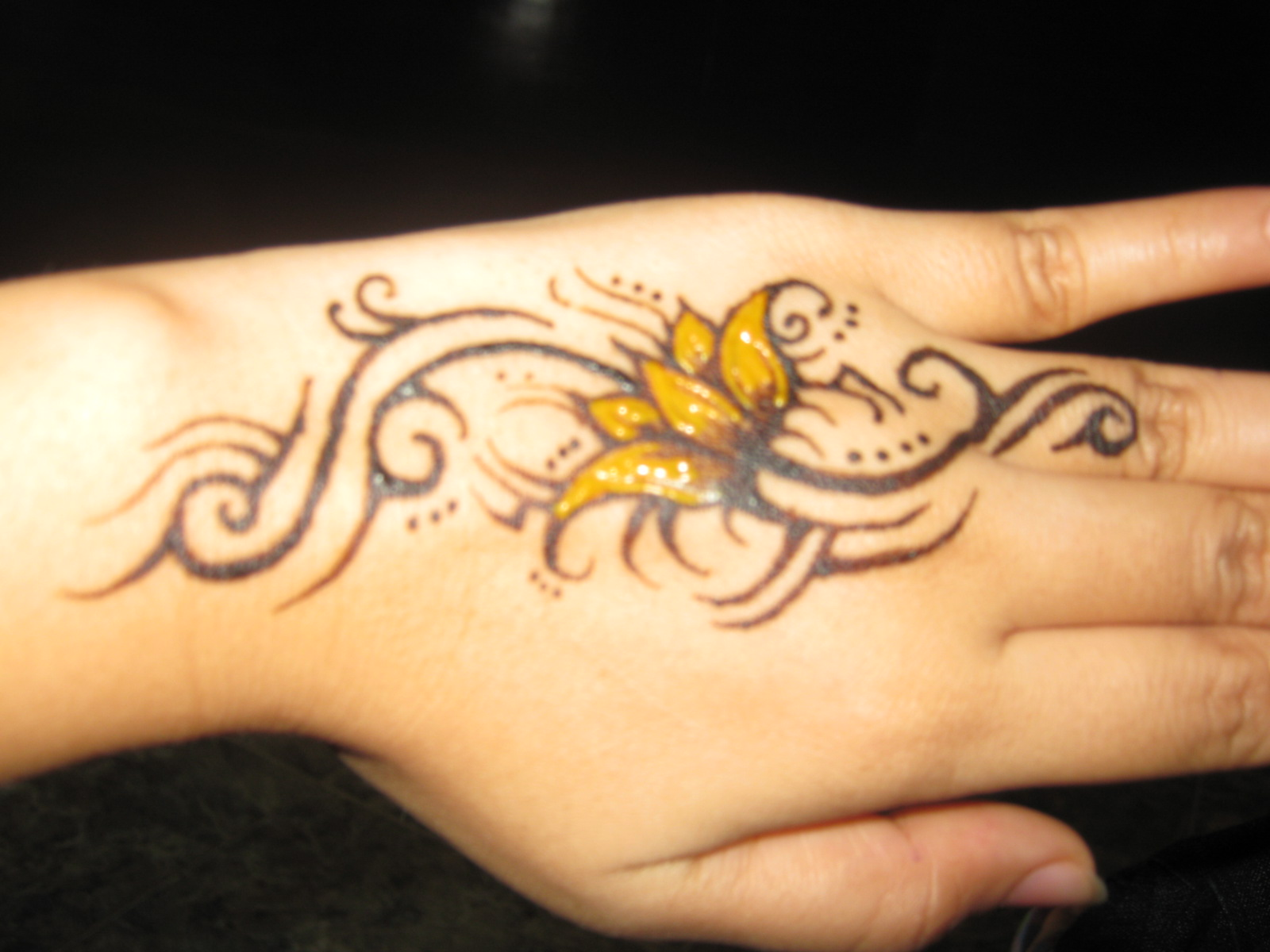 Pictures of flower tattoos beautiful flowers for Flower tattoos on hand