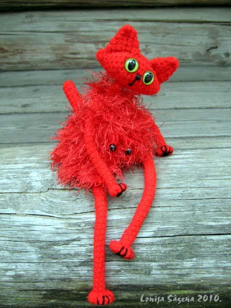 tamborēts kaķis,sarkans vestes kaķis,lofonsa