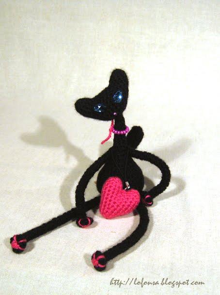 tamborēts melns kaķis ar sirsniņu,sliņķis,lofonsa