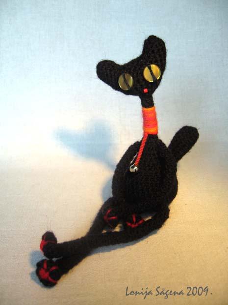 tamborēts kaķis,melns kaķis,sliņķis,lofonsa