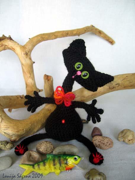 tamborēts kaķis,melns,bučiņkaķis,pirkstiņu kaķis,lofonsa