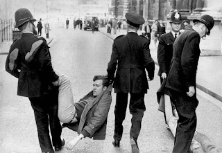 A young trouble-maker carried off by the police!