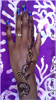 gilded henna tattoo for women of color