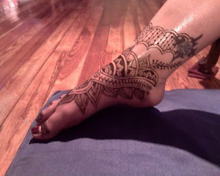henna tattoo inside of foot