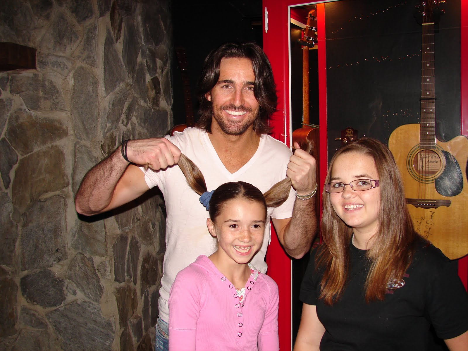 All american jess jake owen and partners in hope standard meet and greet hes got the mg face down pat lol however he broke form for this one he thought the little girls pigtails were cute m4hsunfo