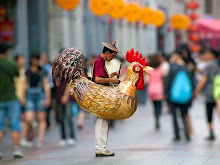 CHICKENMAN sells candy in China.