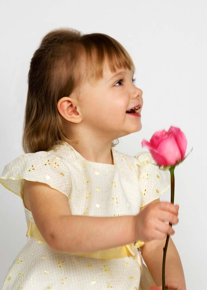 child with rose portrait by Jean Jeanne Selep Imaging
