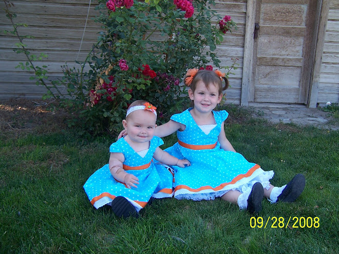 Our Girls in the dresses Malinda made them