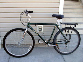 Jerry's new used bike in front of our house in Grand Junction