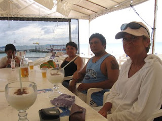 Cervezas and pina coladas at Playa Tiburon on Isla Mujeres, with Manolo, Paula, Juan and Nan, while we wait for tic-n-xic barbecued grouper