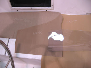 Sunbrella fabric samples in heather beige, beige and toast, and clear plastic dodger windshield material