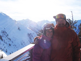 Christmas in Aspen: Nan and John at Aspen Highlands, with Pyramid Peak and the Maroon Bells in the background