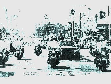 11/18/63: agents on rear of car, excellent motorcycle and press formation