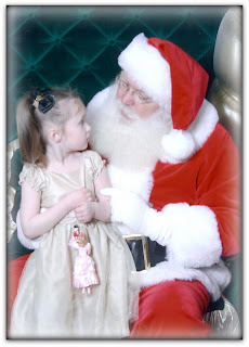 Kylie and Santa 2010