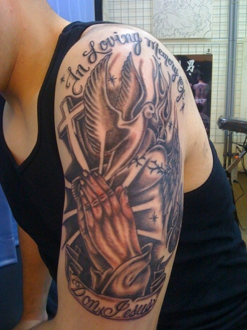 tattoos on shoulder for men. cross tattoo designs for men