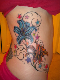 stars tattoo and lilies tattoo