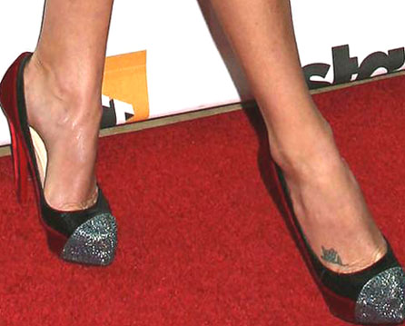Charlize theron tattoo design on foot