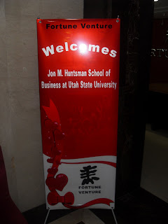 A banner from Fortune Venture welcoming Utah State students