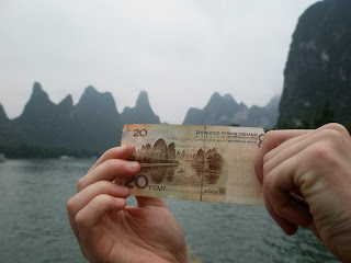 A student holds Chinese money