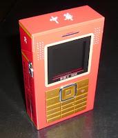 Téléphone GSM - Lecteur MP3/MP4 - Apapreil photo - Paquet de cigarettes