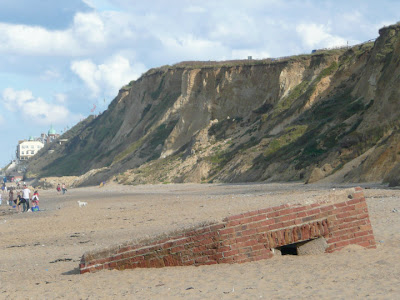 An old Pillbox lies sunken in the sands close to Cromer