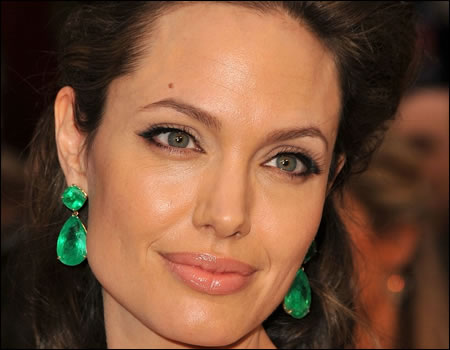 Angelina Jolie in a beautiful green dress on emerald green earrings inspired