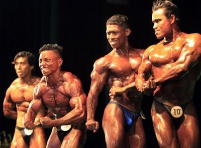 >bodybuilders in a Rangon contest