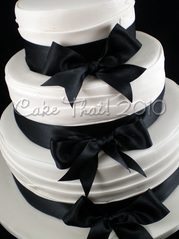A Black and Ivory Themed wedding the cake was a variation of my wrap style
