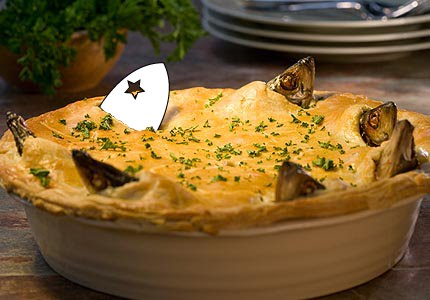 A Stargazy Pie with the Stargazy Studios logo replacing one of the fish heads.