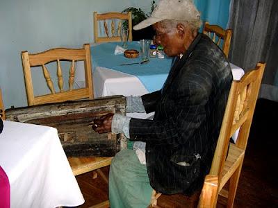 100 year old Malagasy folk musician Dadalira with his marovany