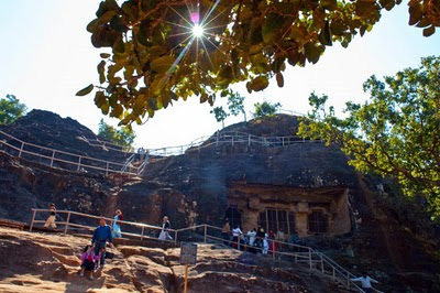 Pandav Gufa at Panchmarhi @ Madhaya Pradesh, INDIA : Posted by Vibha Malhotra @ www.travellingcamera.com : Pandavs seem to have walked all across India during their 13 years exile. All states have pandav gufas or temples constructed by them. The gufa at panchmarhi is spectacular. The massive igneous rock has been cut and carved beautifully.Centuries old Staircase Leading up to the Terrace. Me inside one of the rooms. The door is big enough for Bheem, the largest of all Pandavs.Pillars and chambers in one of the Courtyard. One of the rooms with three windows. The gufa is actually a multilevel house : panchmarhi, Madhya Pradesh, vibha malhotra, Pandav, Gufa, Pandav Gufa, Central India, India, Tourism, Travel