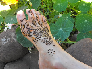 one foot with henna