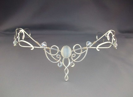 The tiara below more Celtic in its feel with spirals and swirls