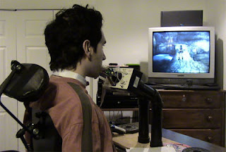 Image of Robert Florio playing Tomb Raider using the head-operated Quad Controller.