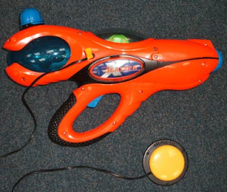 Image of a red X-Blaster water pistol adapted with a separate Able-net switch attached.