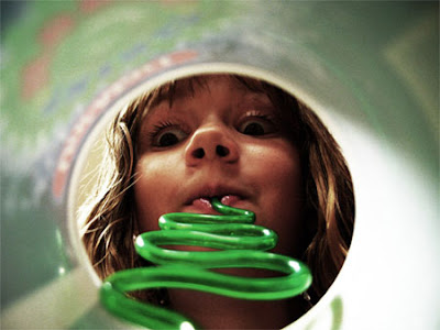 Image of a girl sipping through a crazy straw - Joe Powell 2005.
