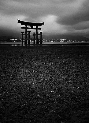 Black and White photo of Torii Gate of Itsukushima Jinjia (Itsukushima Shrine) located on Itsukushima Island (popularly known as Miyajima) in Japan - Pawel Maciejewski