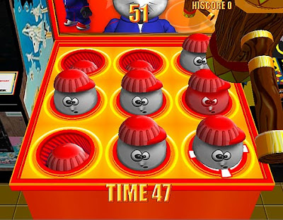 Image of the cartoon-style Whack-a-Monty Mole game in action.