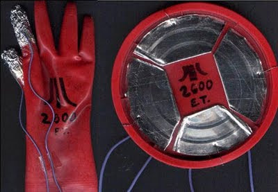 Image of a D.I.Y. glove and hacked can to make a touch sensitive game controller for an Atari 2600.
