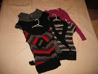 Four knitwear tops