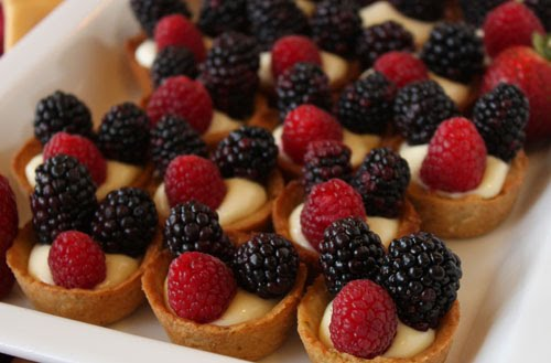 berries on a light and luscious lemon cream in a sweet pistachio tart ...