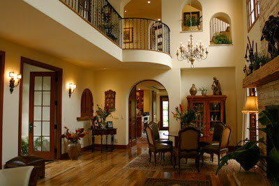 This mediterranean style room with the arched doors and wall insets