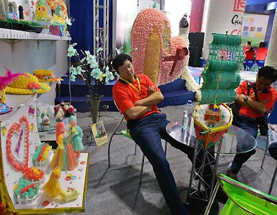 workers sleeping among condom creations