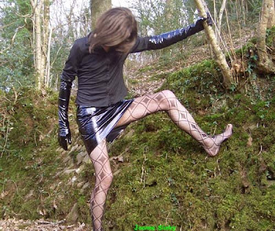 Joanna Slinky in PVC gloves and skirt, and patterned hose tights